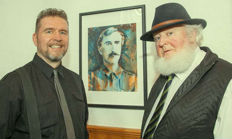 Proinsías O' Rahilly gives the seal of approval to his grandfathers portrait. Rod Coyne Exhibition in The Courthouse Art Centre, Tinahely. Photo Joe Byrne.