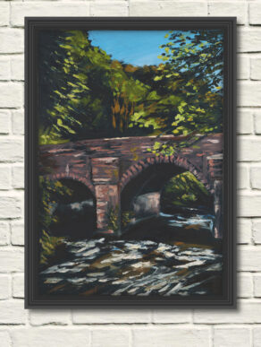 artist rod coyne's oil painting of the bridge over the meeting of the waters. here as a canvas print in a black frame on a white wall