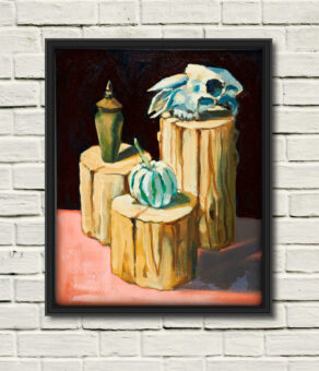 Rod Coyne's painting: Sheep Skull Still Life in a black frame on a white wall