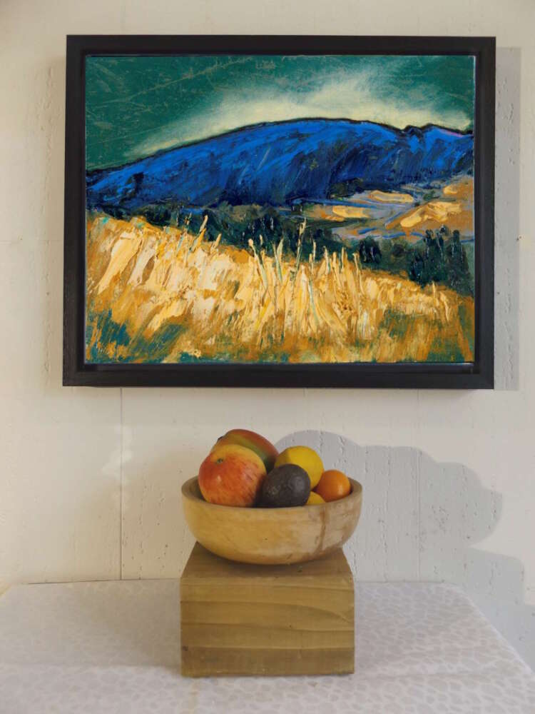 Sleeping Giant canvas print hung with apples in the foreground for scale.