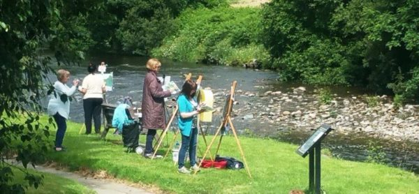 Students getting to grips with the Meetings as outdoor painting workshop location.
