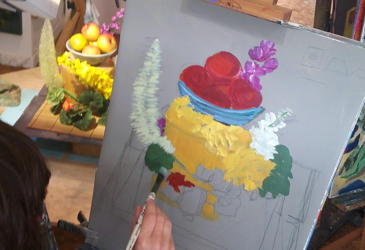 Painting a riot of colour in the studio.