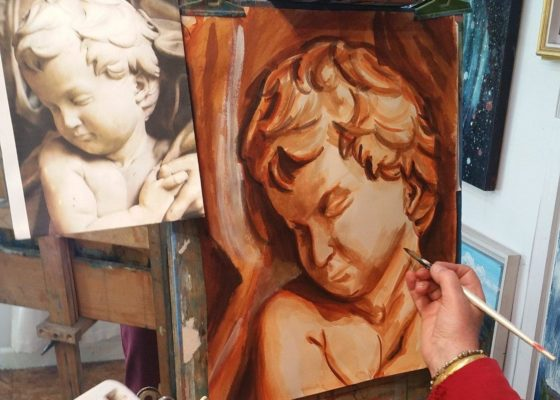 Art student paints cupid in raw sienna. Autumn Painting Course.