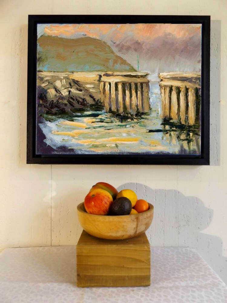 Greystones Harbour framed canvas print with fruit bowl.