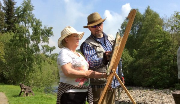 Rod Coyne explaining painting techniques for working outdoors.