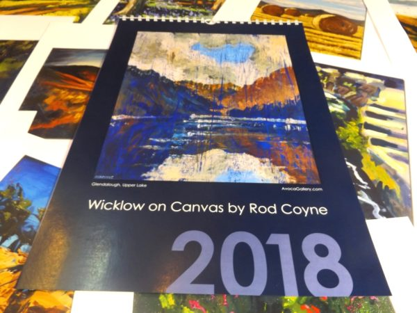 """2018 Calendar choice is Rod Coyne's """"Wicklow on Canvas"""". Here we see the midnight blue cover resting upon twelve months of loose pages."""
