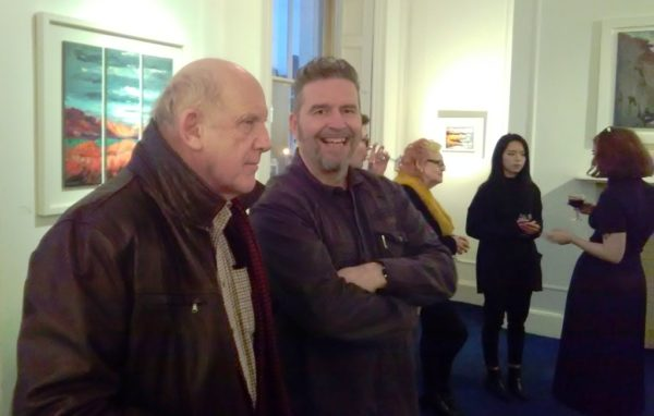 Rod explains his method for Seeing Red to a guest at his exhibition launch at the Origin Gallery, Dublin.