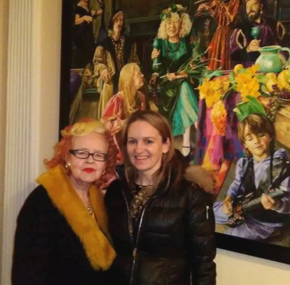 Gallerist and curator Dr. Noelle Campbell-Sharpe with an interested collector.