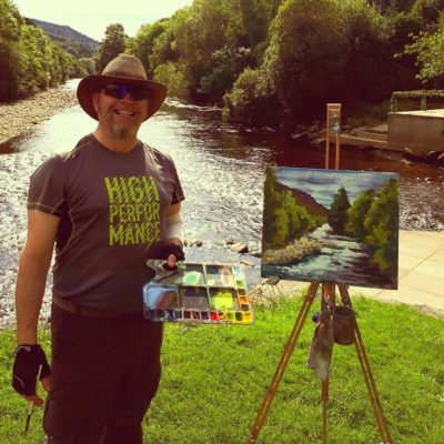 Rod Coyne with his just completed Meetings painting demo on the easel.