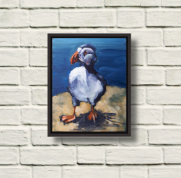 Photo of Rod Coyne's Patrolling Puffin acrylic on canvas, black-framed, on warm wall.