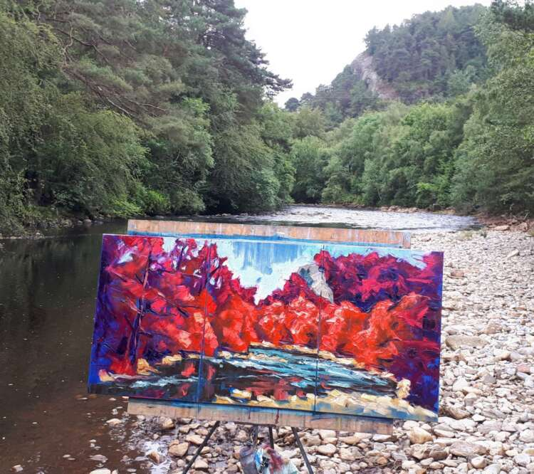 artist rod coyne's triptych painting is shown here on the, just finished on location beside the avoca river.