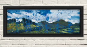 """artist rod coyne's landscape """"Wicklow Hills"""" is shown here in a black frame on a white wall."""