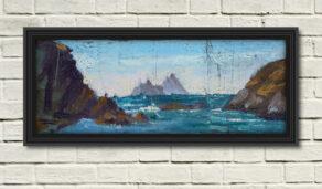"artist rod coyne's landscape ""Skellig Summer Mist"" is shown here in a black frame on a white wall."